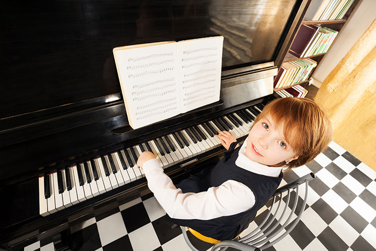 Boy playing piano at Quassica Music